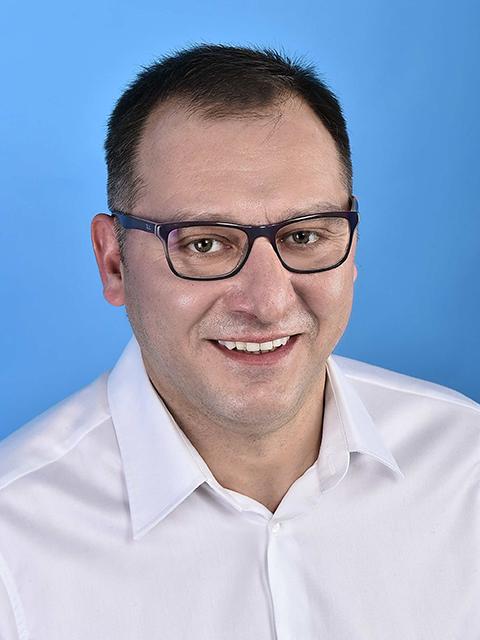 Dr. Zoltán SZREBRÓ